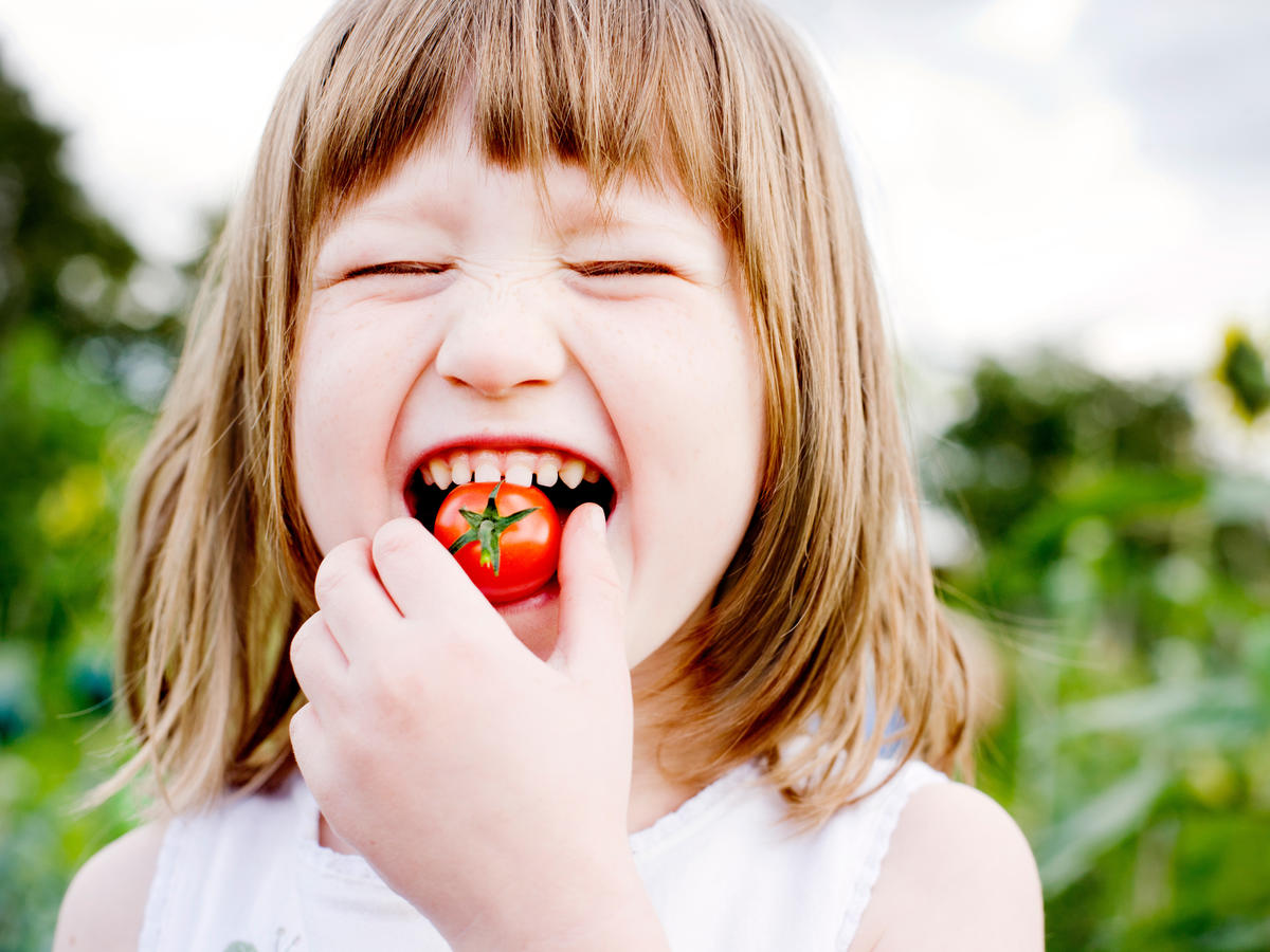 Kid Eating Tomato
