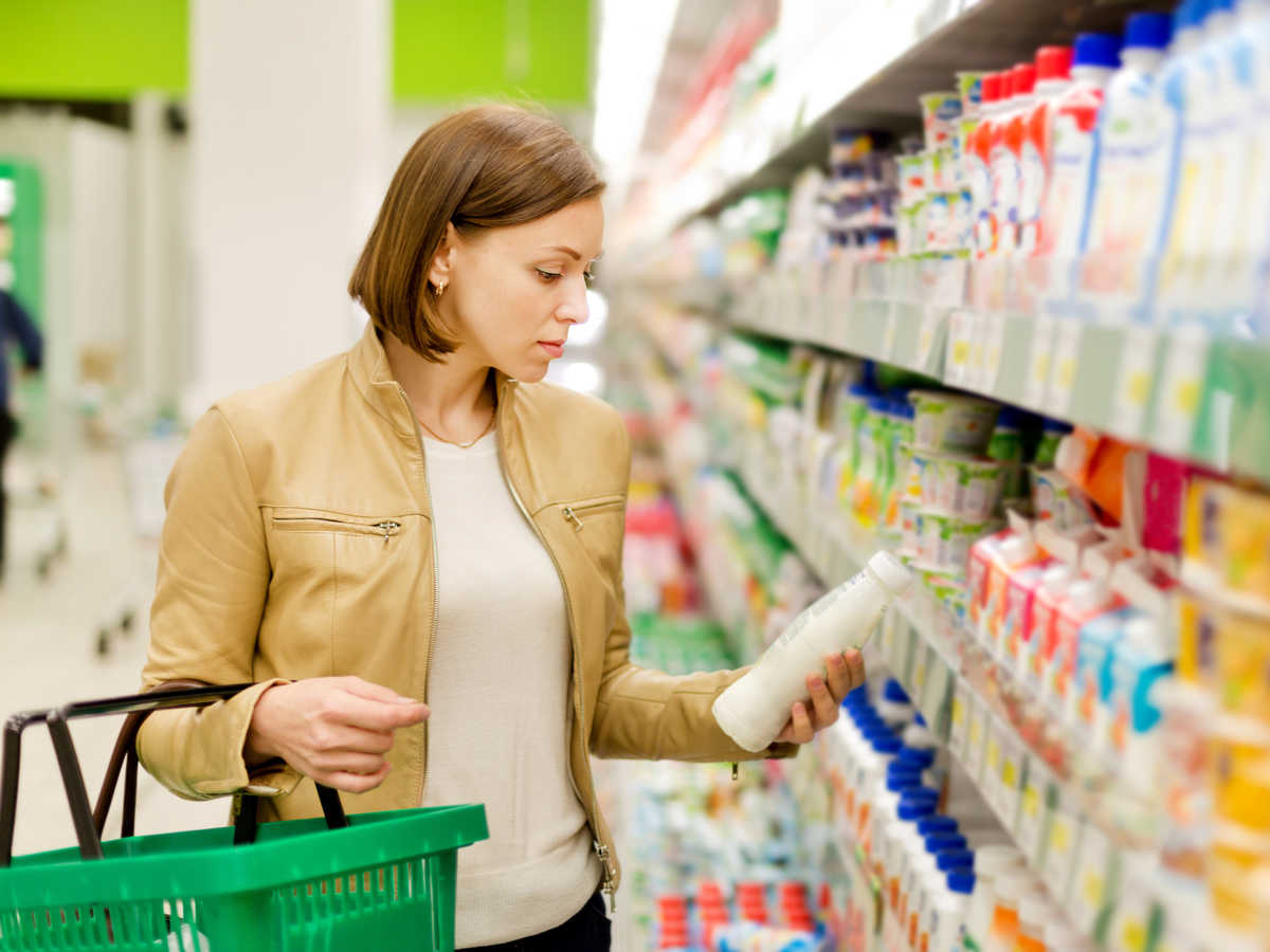 Woman Reading Food Ingredient Label