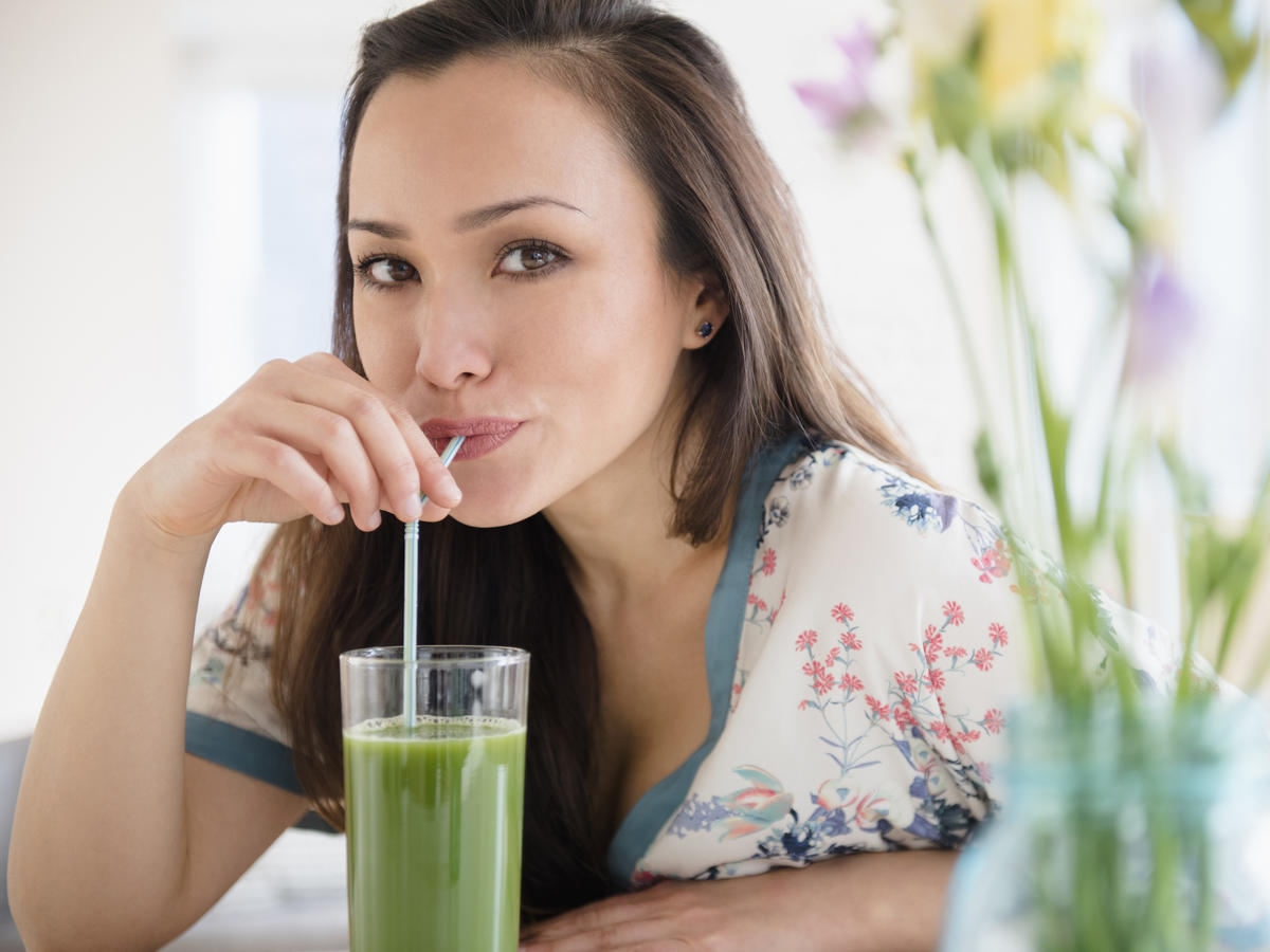 Woman Drinking Green Juice