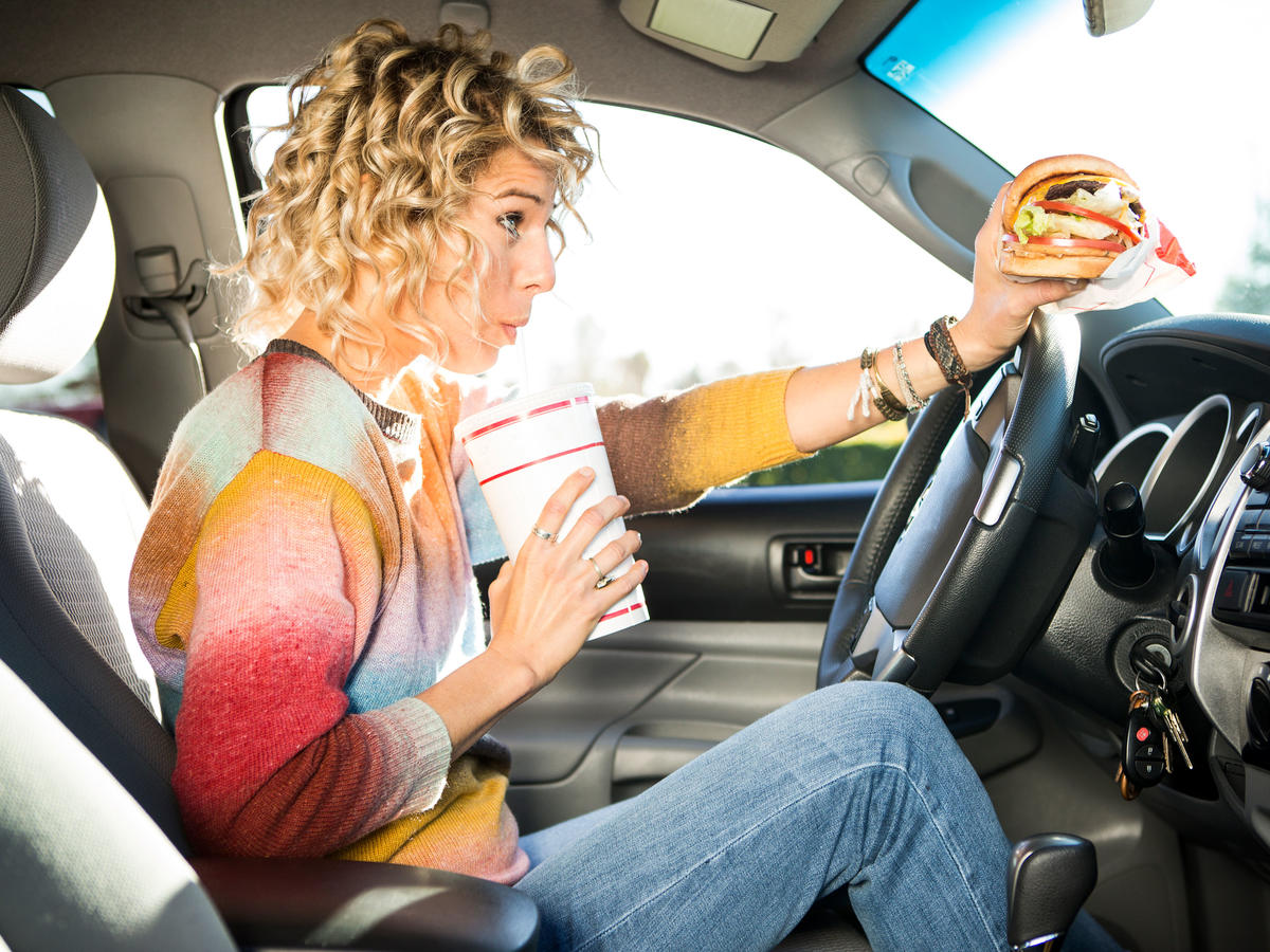 Woman Driving Car and Eating