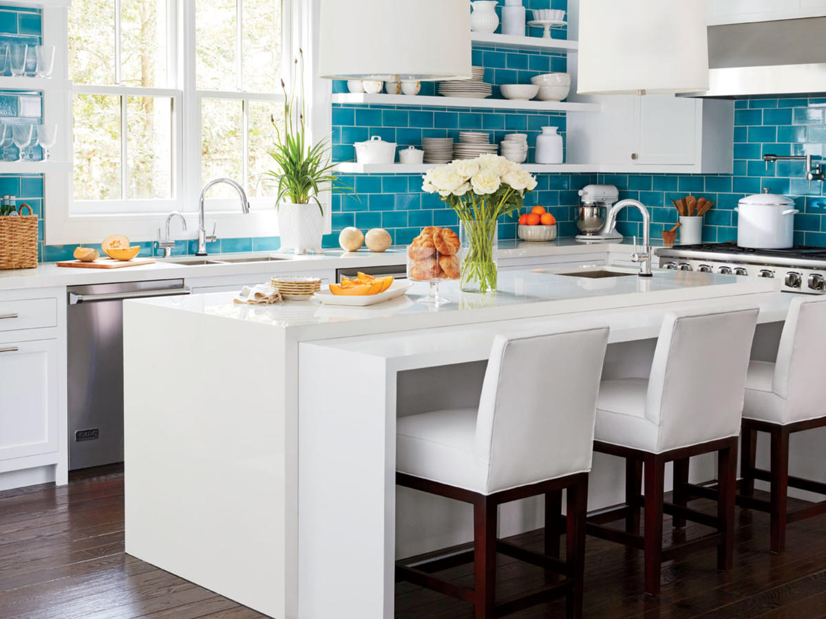 White Kitchen with Blue Tile Wall