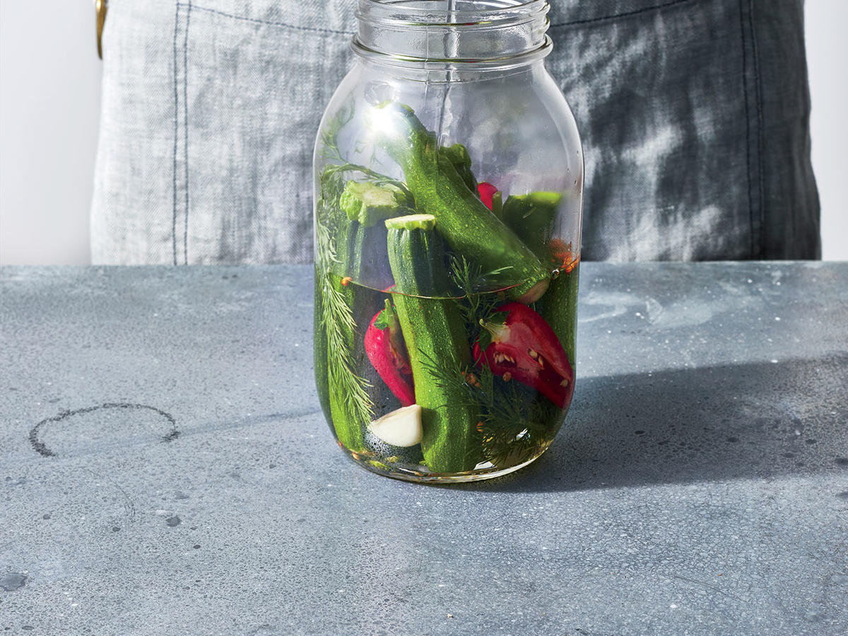 Cover pickles with brine.