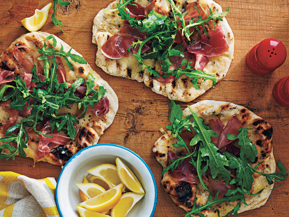 grilled pizza prosciutto arugula lemon