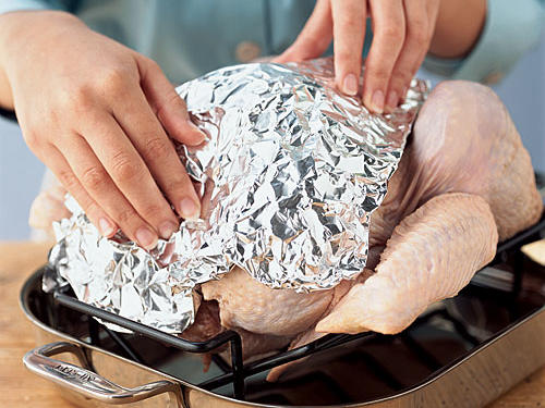 Cover breast with foil to keep the white meat from cooking too fast. This will help you achieve moist, tender cuts.
