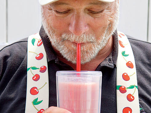 sipping a cherry-infused smoothie at the National Cherry Festival in Traverse City