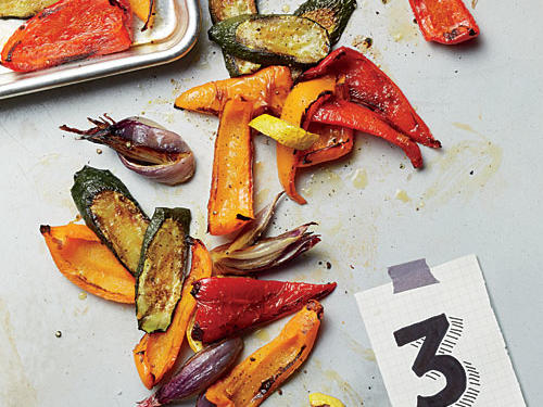 Why do you preheat pans in the oven before roasting vegetables?