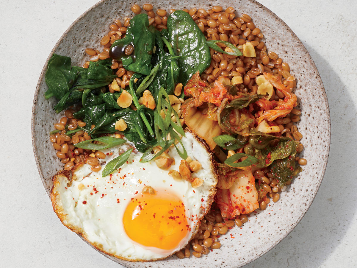 Wilted Spinach and Fried Egg Wheat Berry Bowl