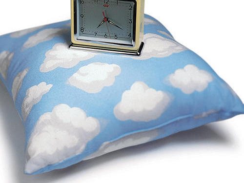 Alarm Clock on top of Cloud Pillow