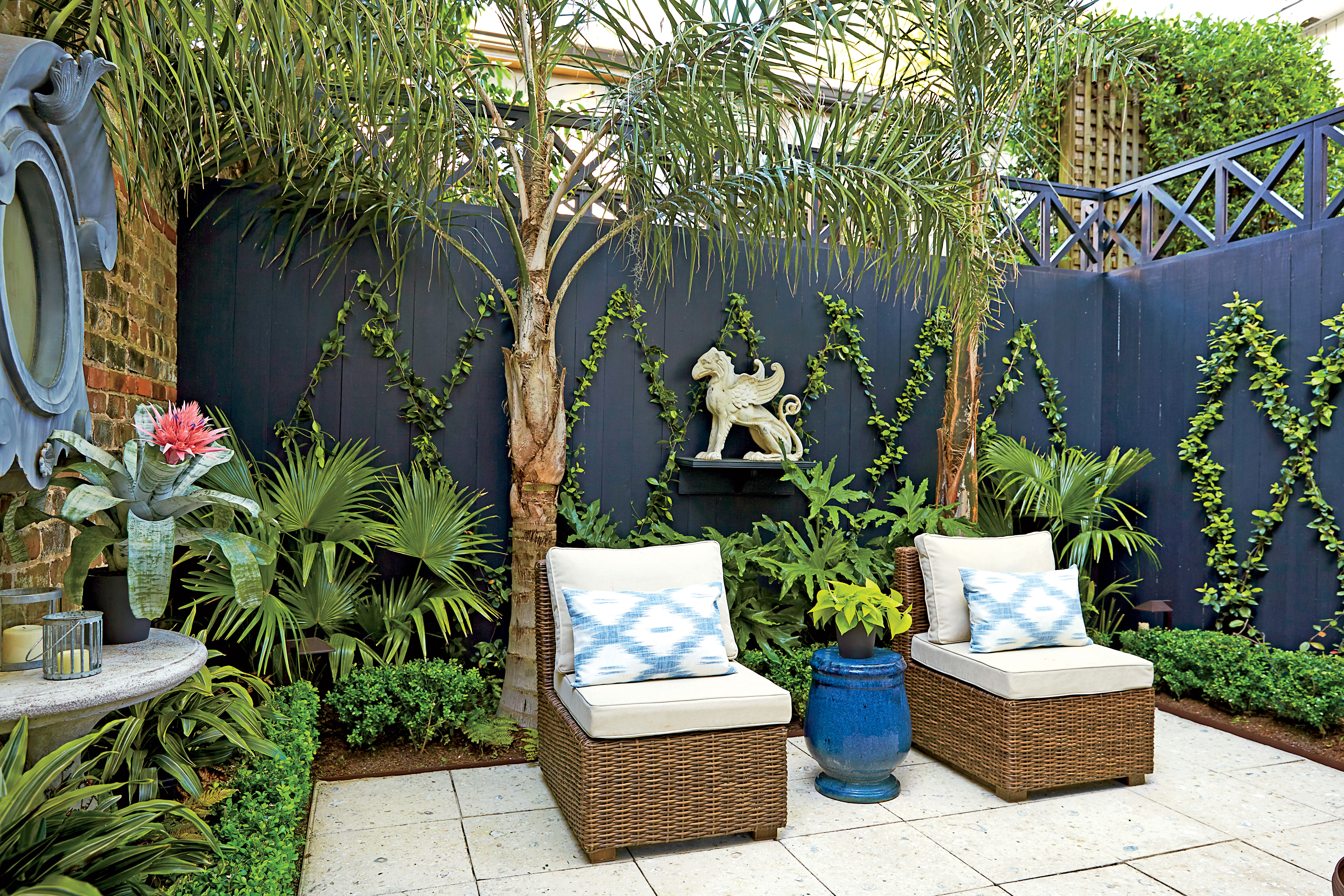 backyard courtyard in savannah with blue accents and ivy trellis