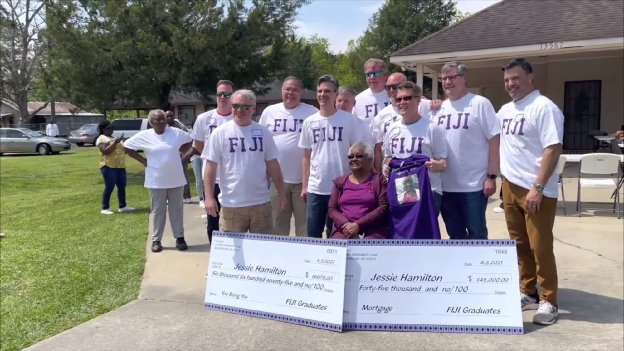 A group of LSU FIJI graduates gathered to surprise their house's former kitchen staff member, Jessie Hamilton, by paying off her mortgage Saturday afternoon, April 3, 2021.