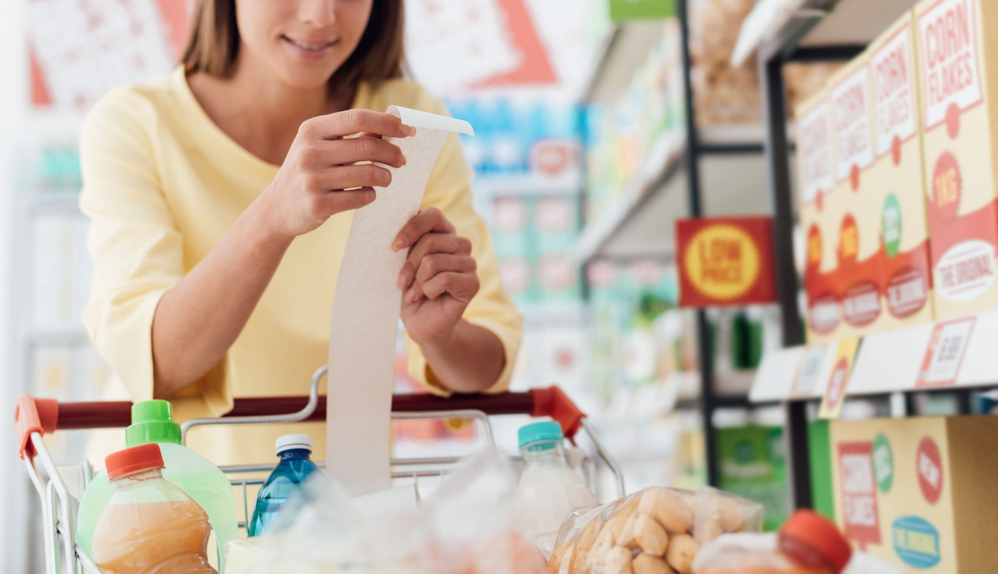 Woman Checking Receipt at Grocery Store