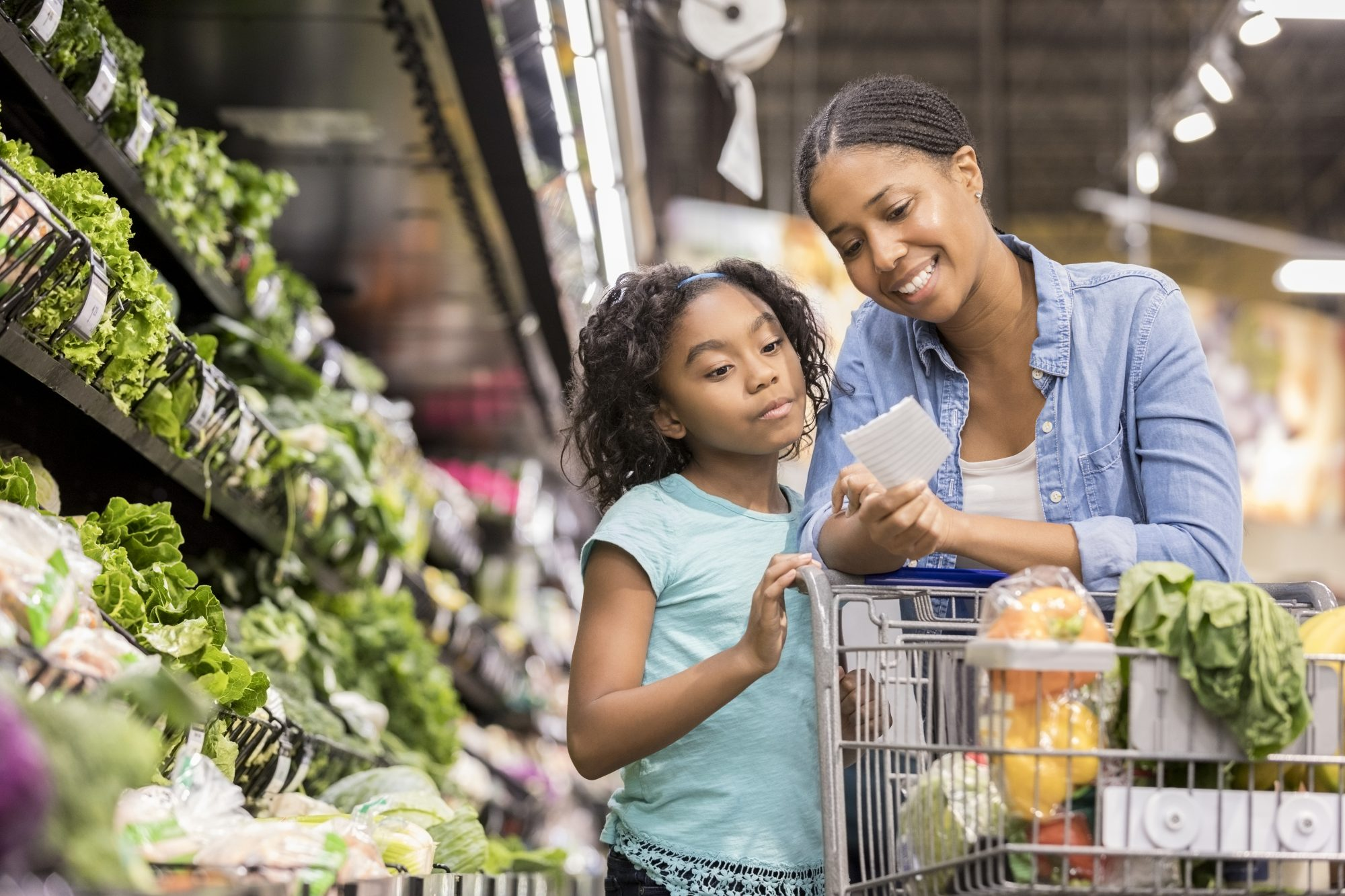 Woman and Young Girl Shopping in Healthy Grocery Section