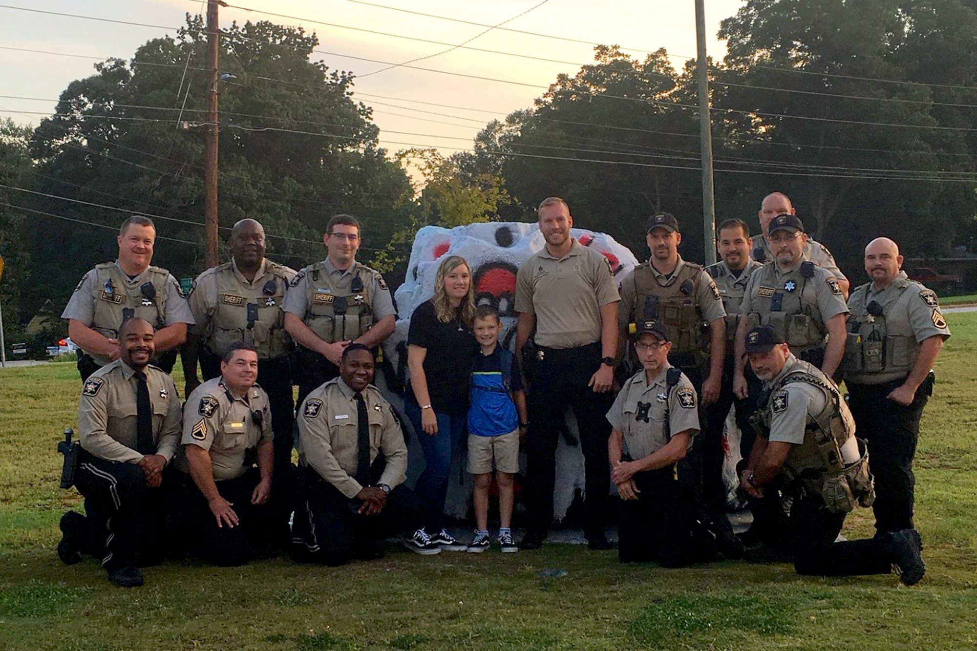 Sheriff's Deputies Escort Boy to School After His Father Was Killed in the Line of Duty