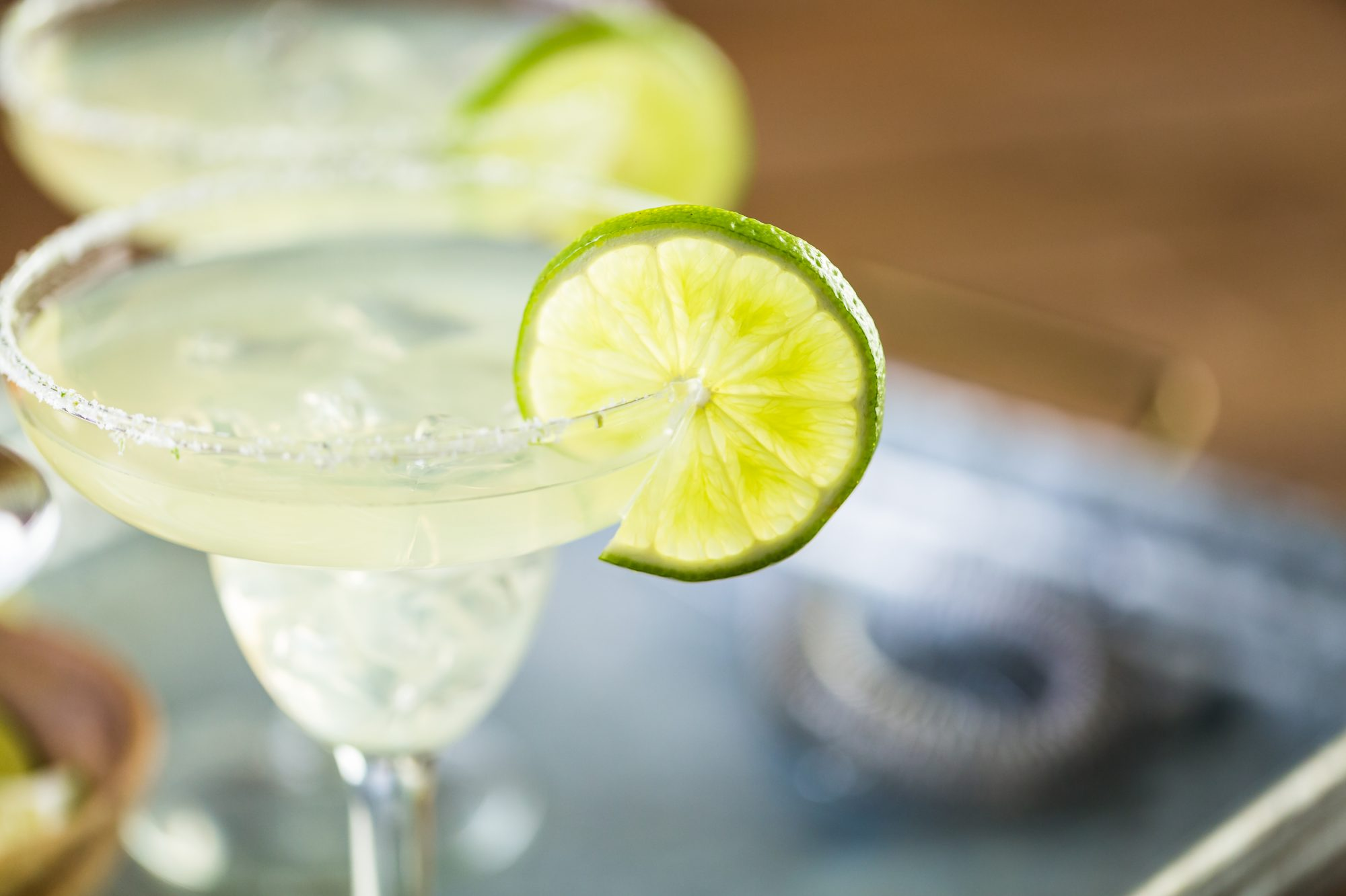 Key lime margarita garnished with fresh lime