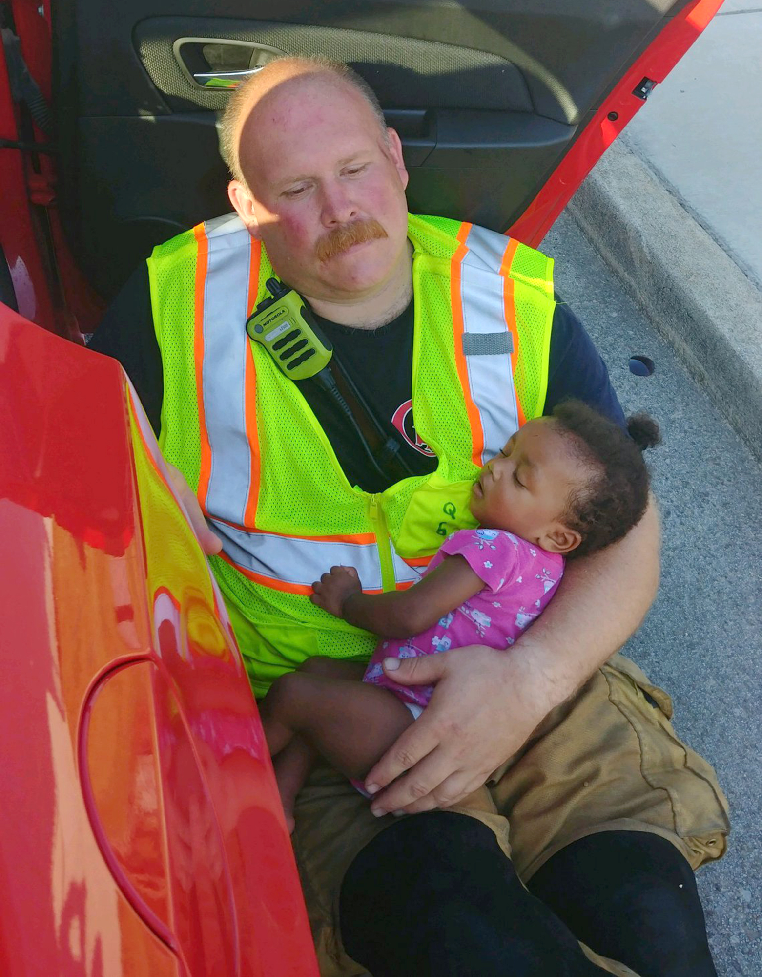 Firefighter Comforts Child After Car Accident in Touching Viral Photo: 'This Is Why I Do My Job'