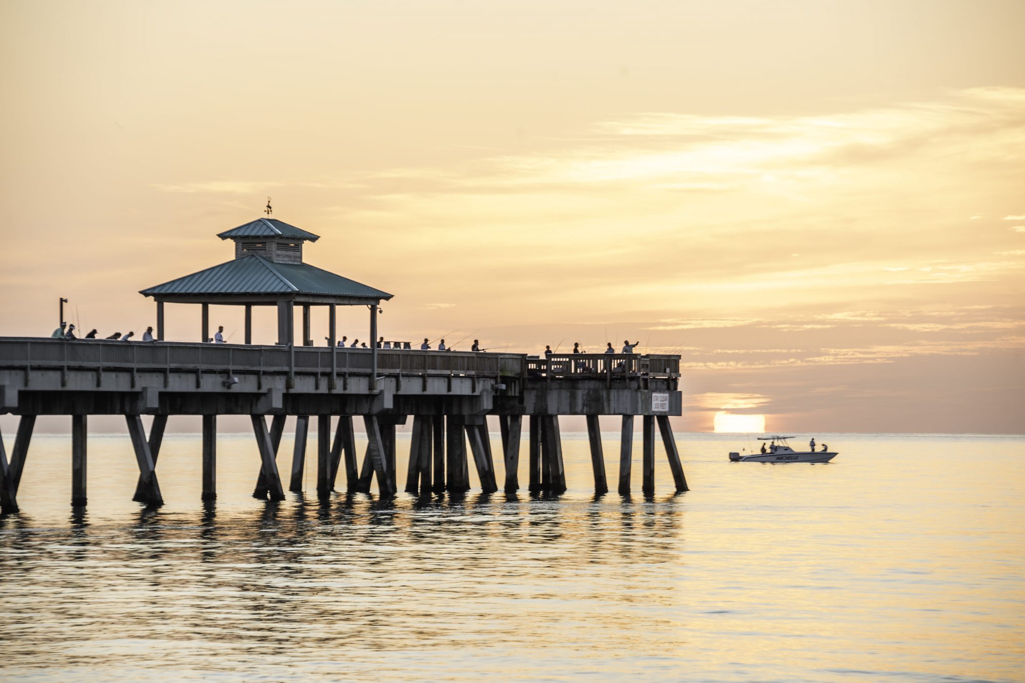 Deerfield Beach Florida Pier Fisherman at Dawn with boat
