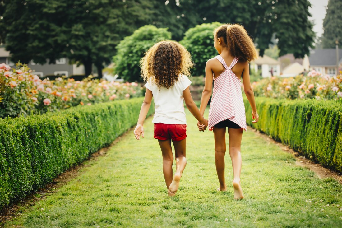 Sisters Walking in a Garden
