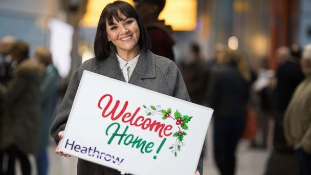 Martine McCutcheon with sign at Heathrow
