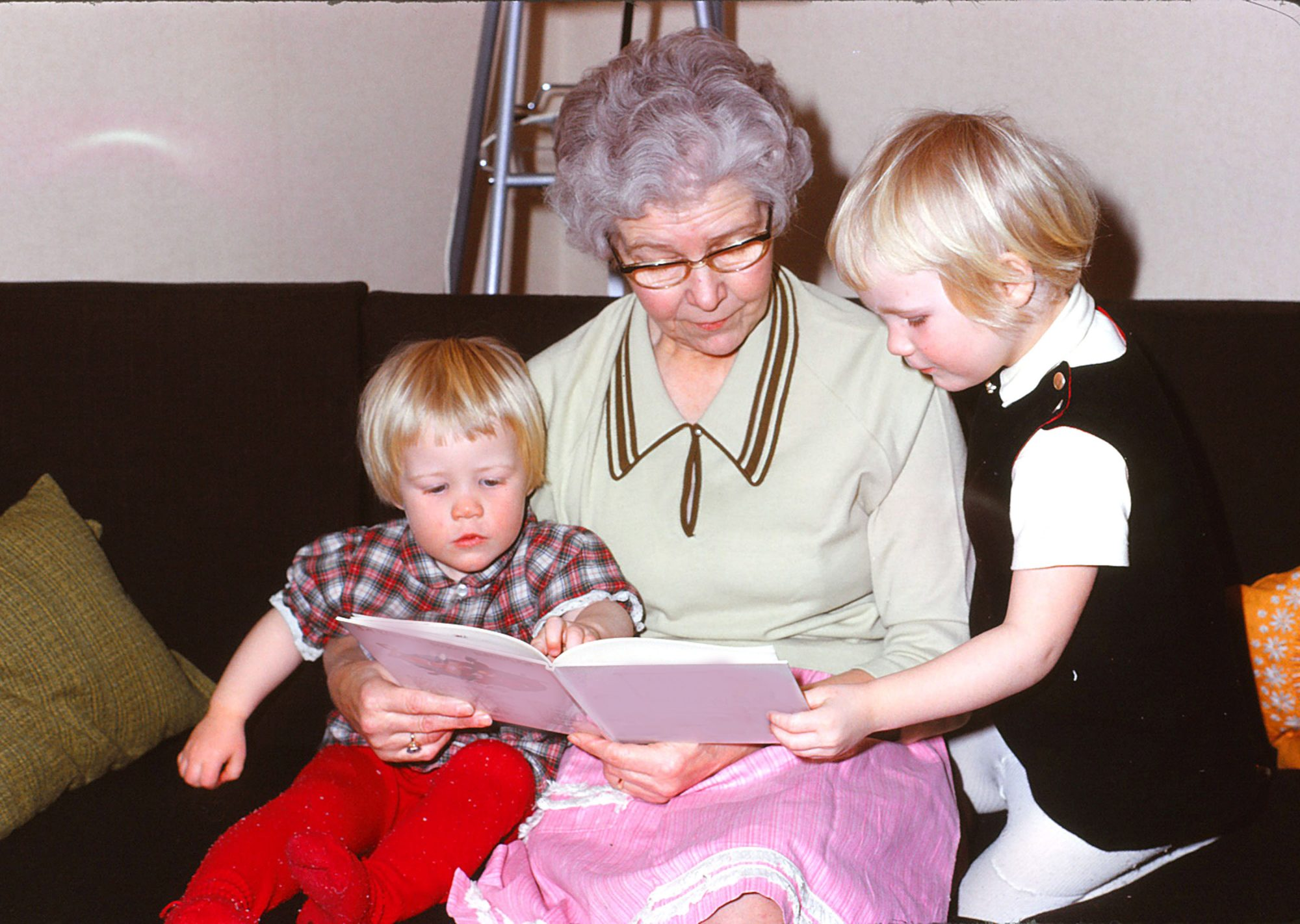 Grandmother Reading Book to Children