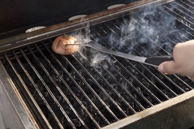 Why You Should Be Cleaning Your Grill With An Onion