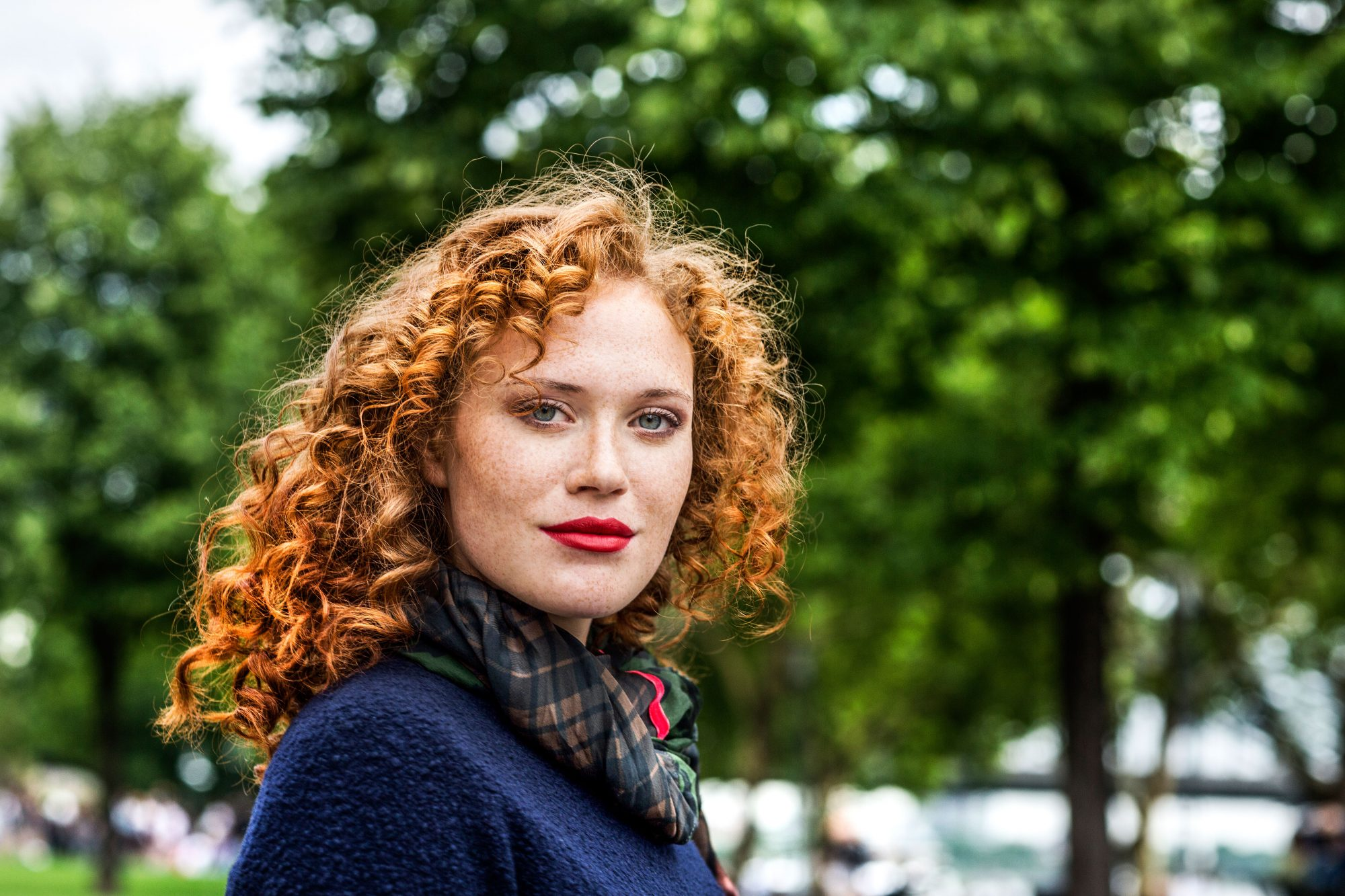 Woman with Curly Red Hair and Lipstick