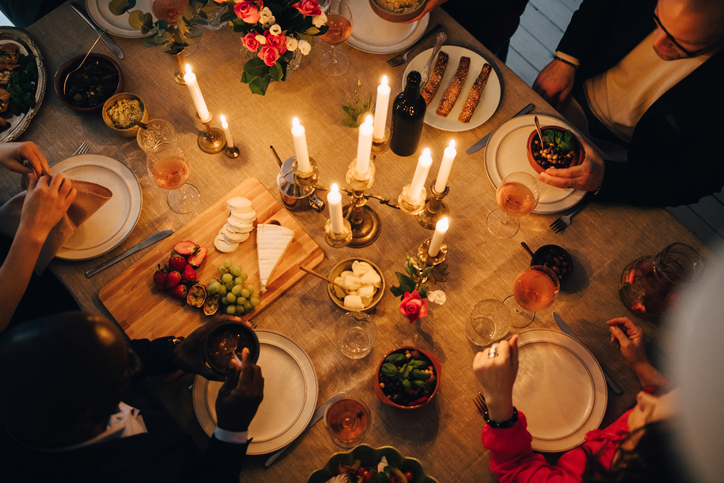 Directly above shot of friends enjoying food at dinner party