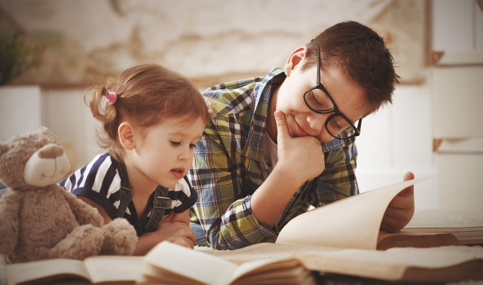 Older Brother Reading with Sister