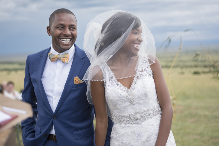 Smiling Bride and Groom at Wedding Ceremony
