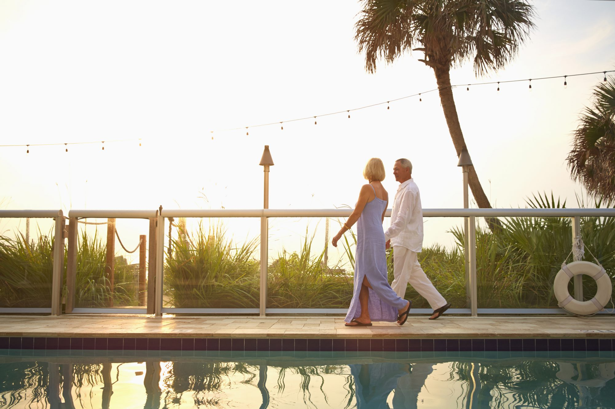 Couple Walking by Pool at Florida Resort
