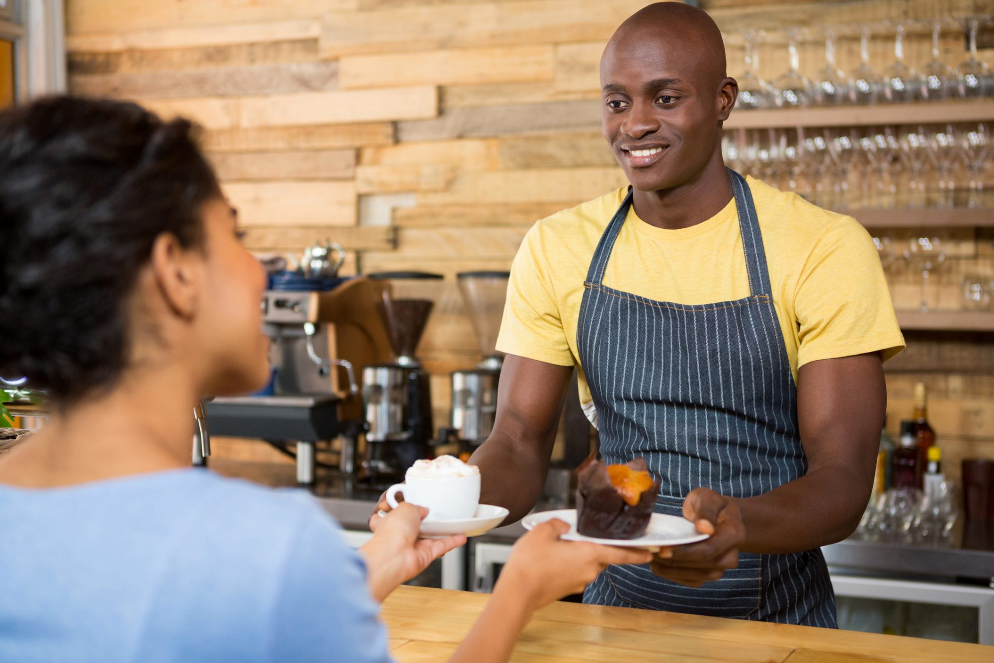 Barista Serving Coffee and Desert
