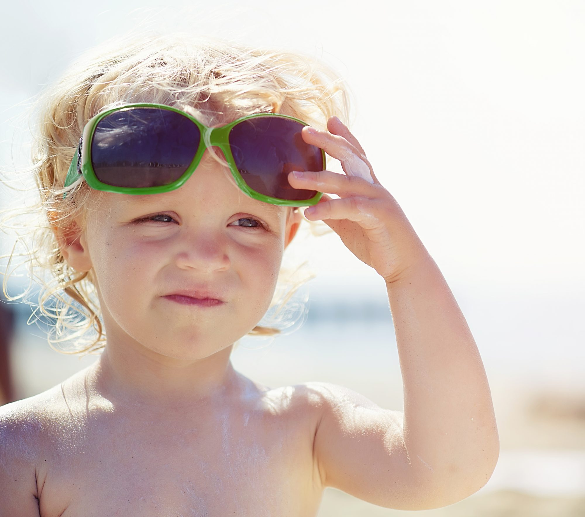 Summer kid wearing sunglasses unhappy