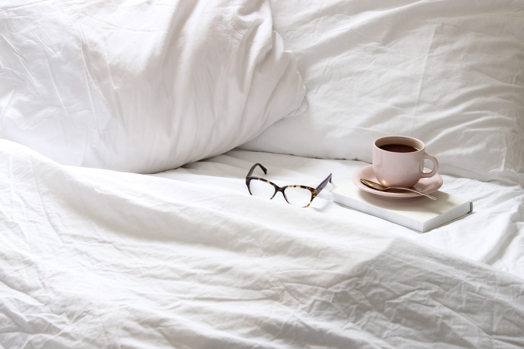 White Bedding with Book and Coffee
