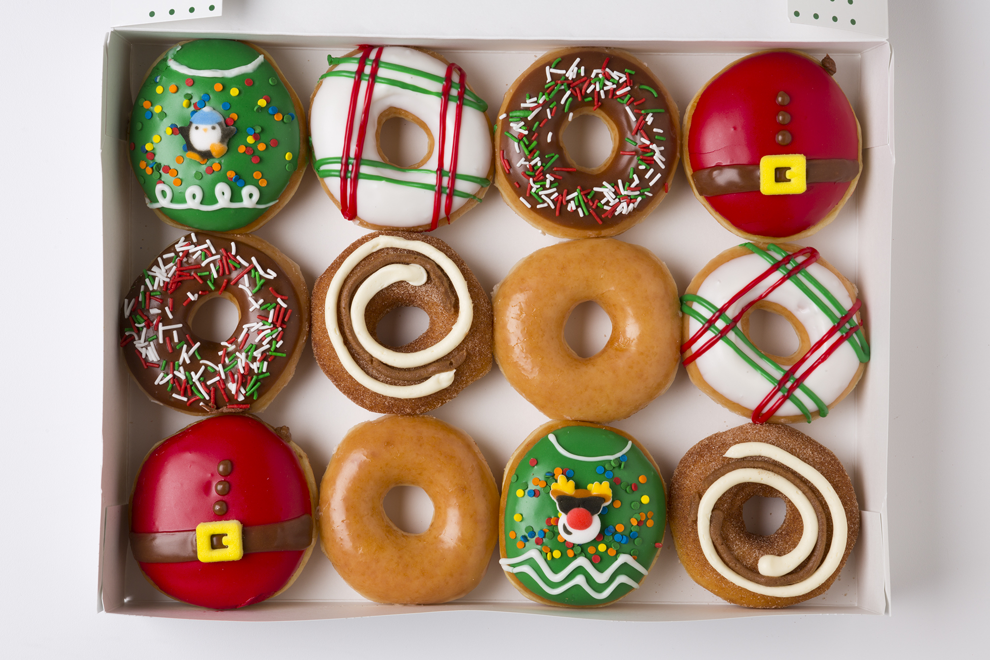 You Can Get a Dozen Krispy Kreme Donuts for $1 Next Week krispy-kreme-holiday-ltos