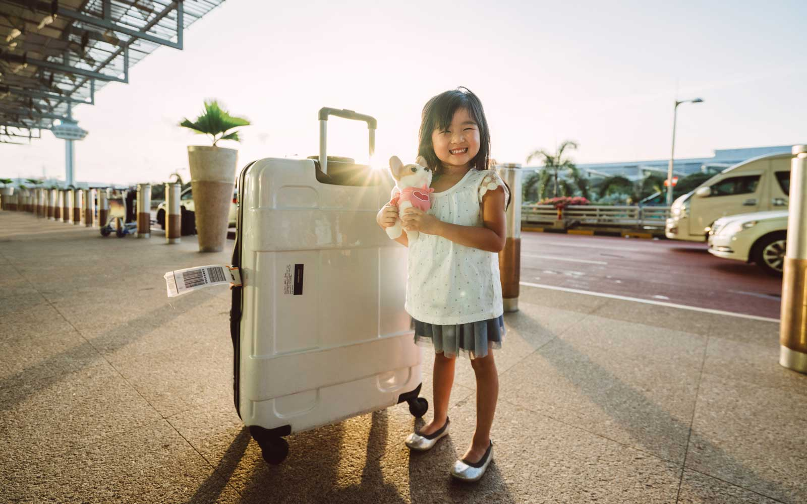 Little girl with her luggage in Singapore