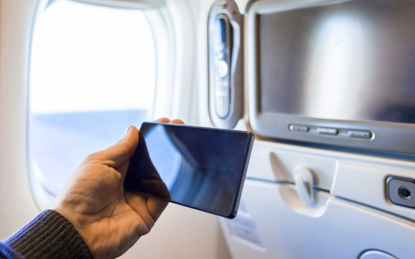 Holding smartphone on an airplane