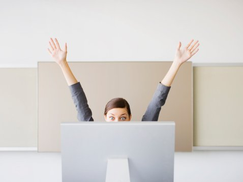 woman-office-computer-cheering