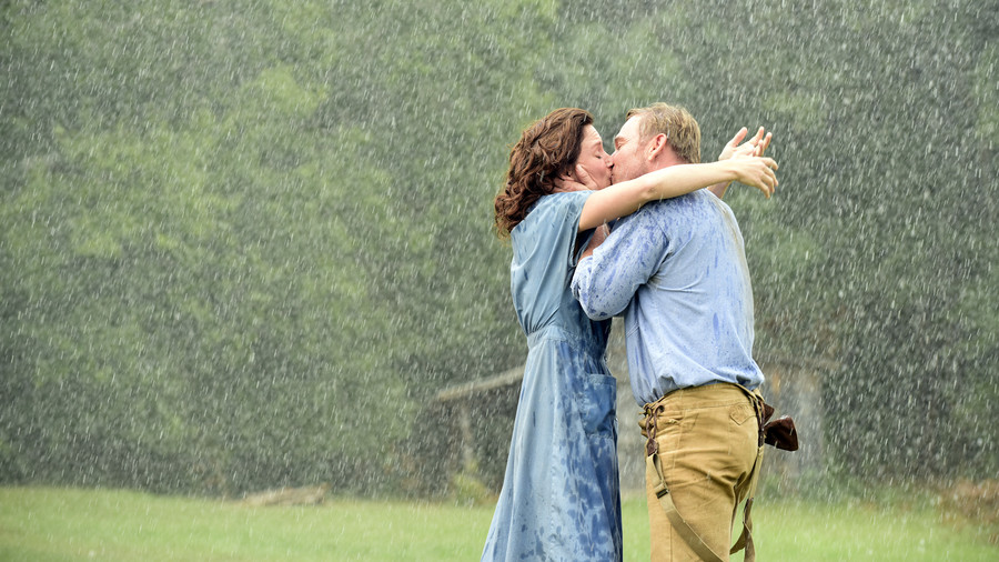 Southern Romantic Gestures Kissing in the Rain