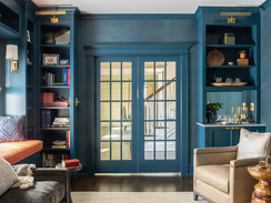 Sherwin-Williams Seaworthy SW 7620 in Library with Built-In Bookshelves and French Doors