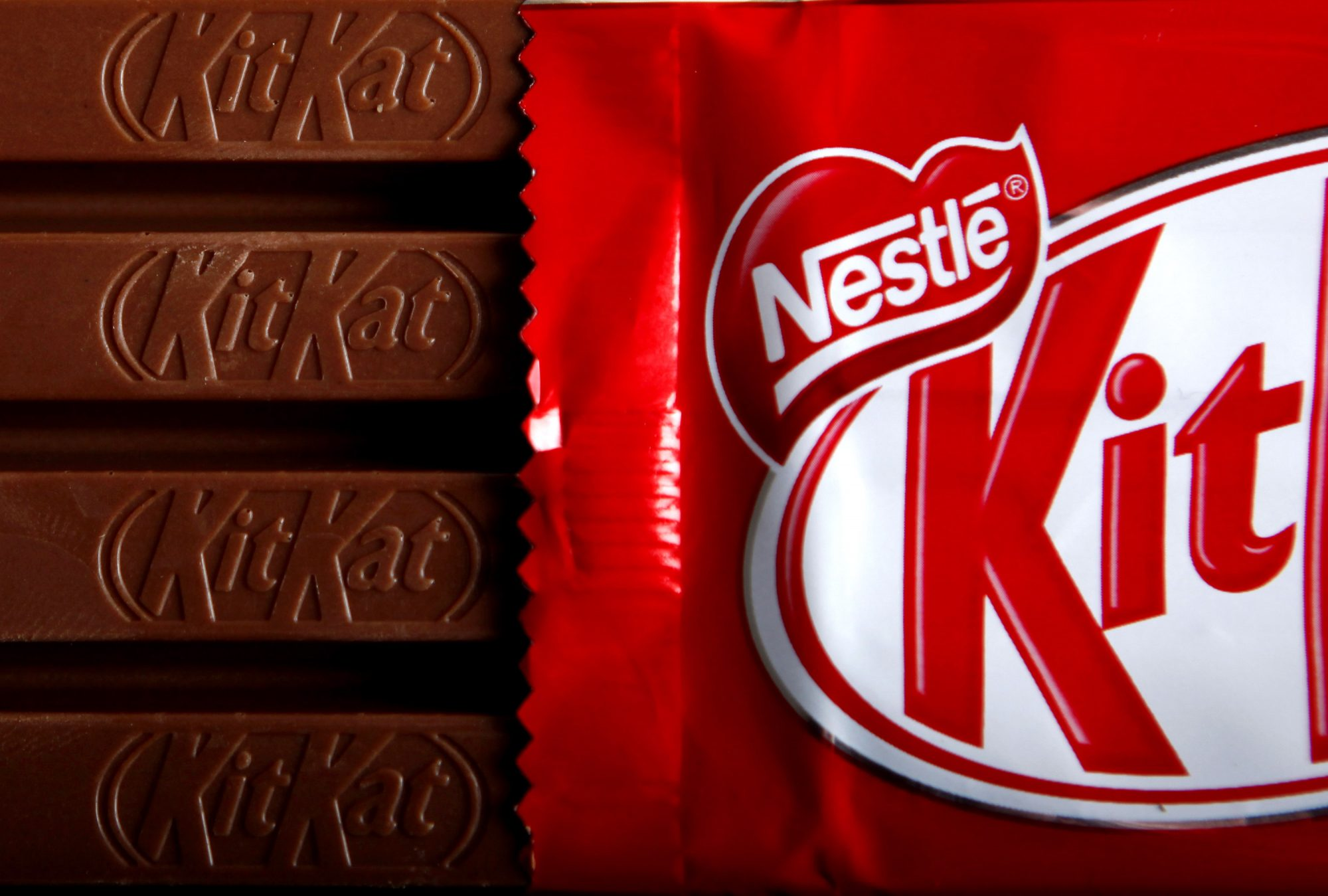 Bars of original KitKat chocolate, produced by Nestle SA, and without the fair-trade logo sit arranged for a photograph in London, U.K., on Monday, Dec.7, 2009. Nestle SA, the world's biggest food company, will start certifying some KitKat bars in the U.K