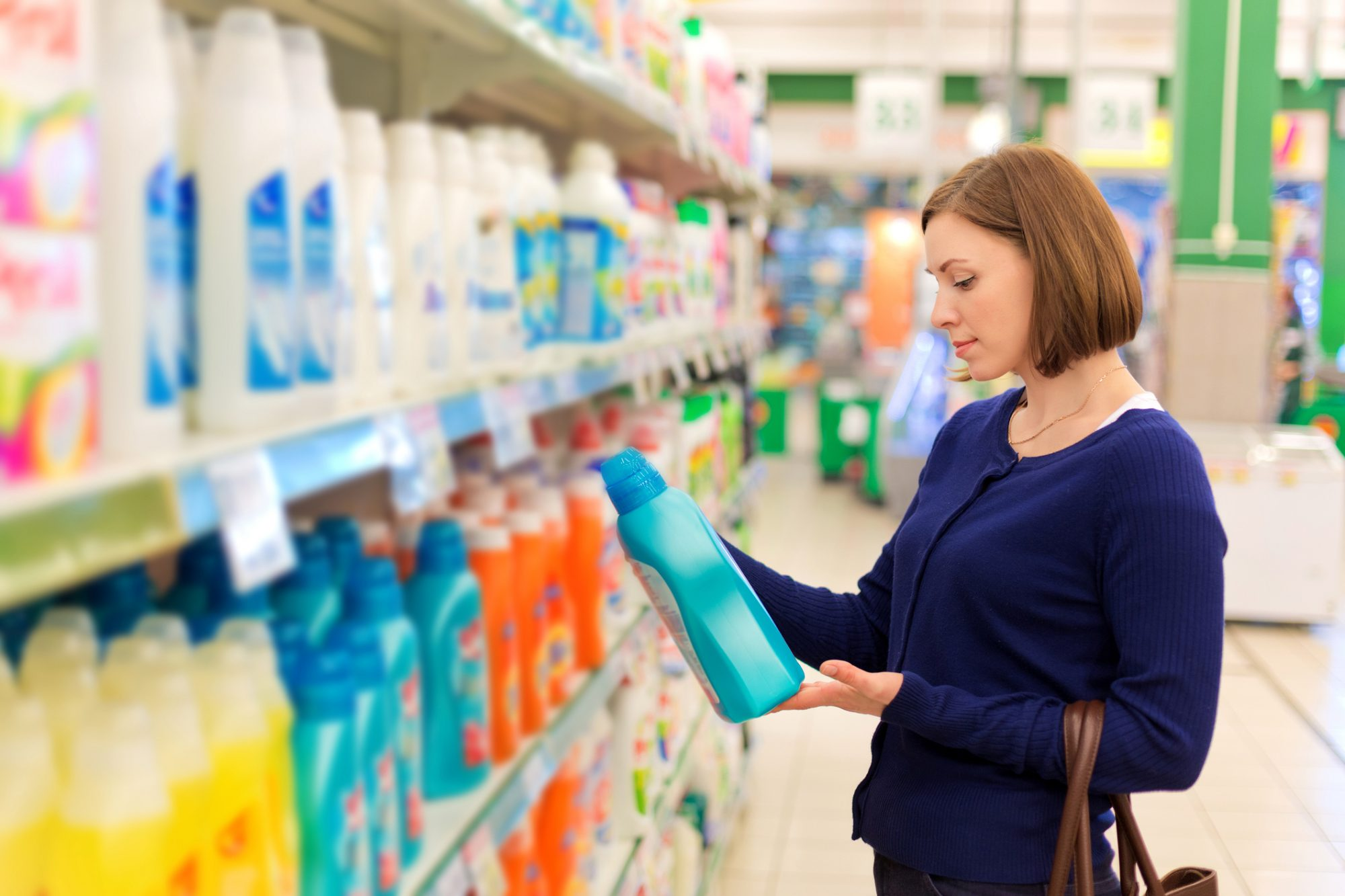 Woman Selecting Detergent