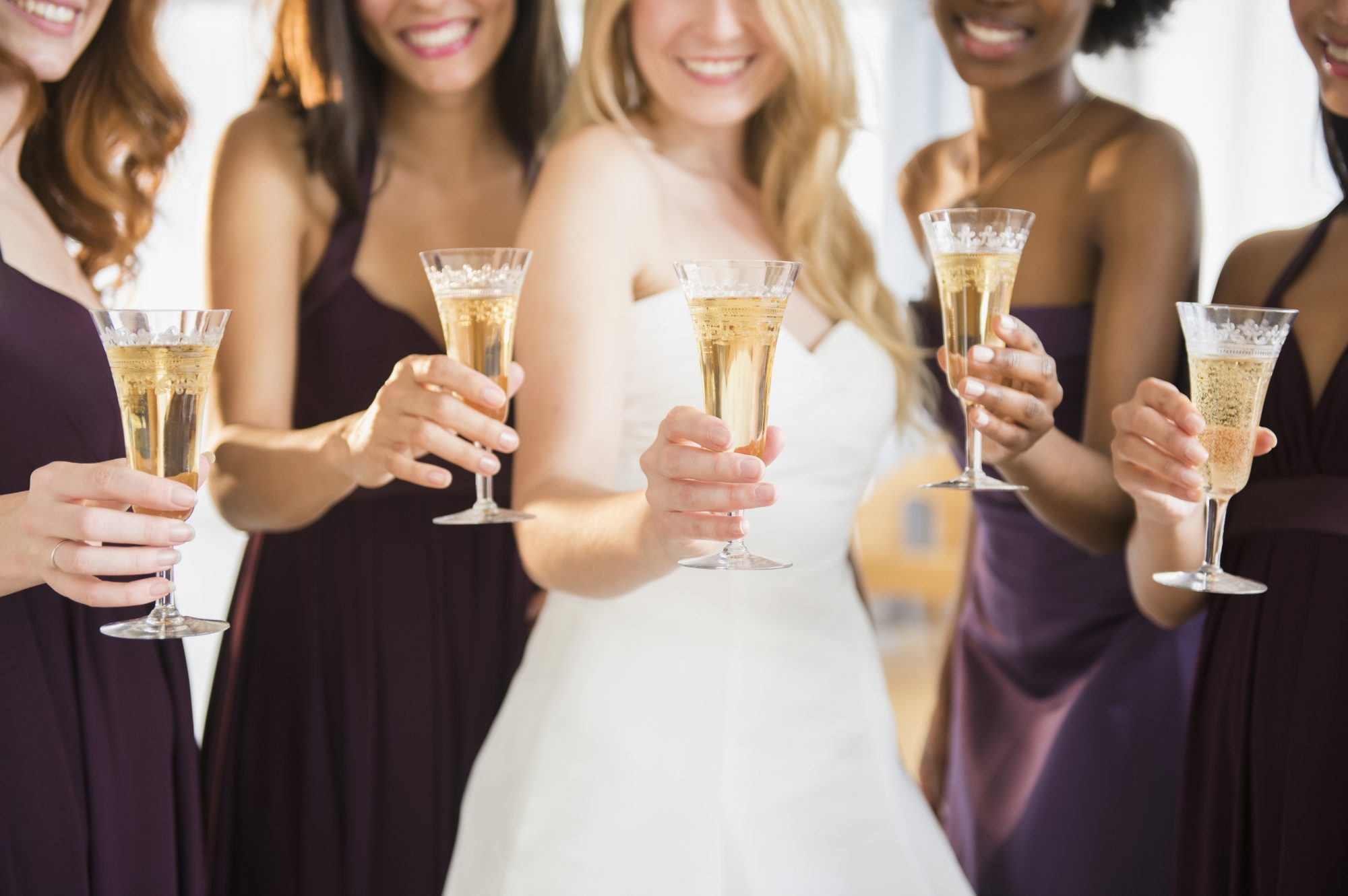 Bride and Bridesmaids Toasting with Champagne