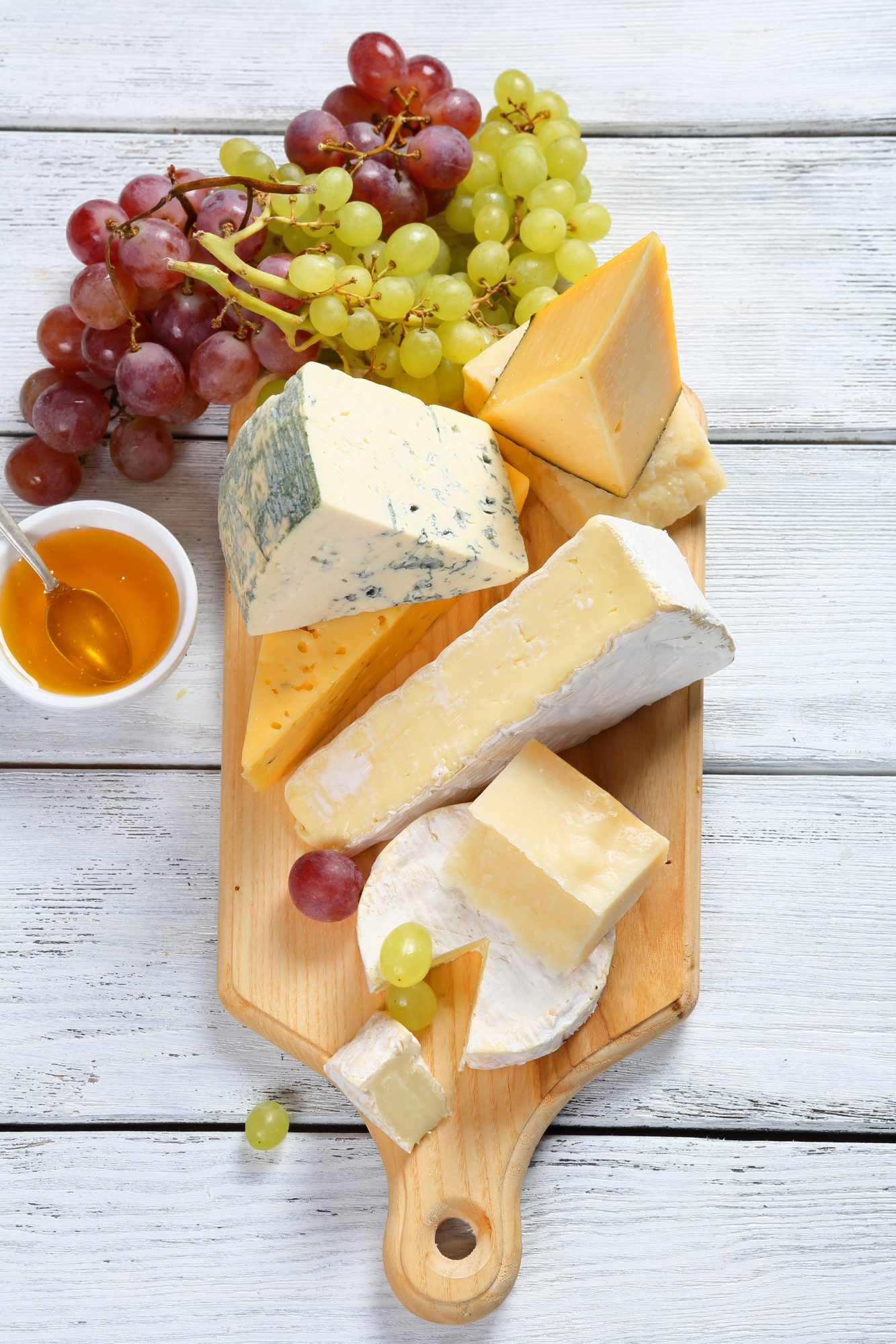 Cheese board with multiple cheese varieties