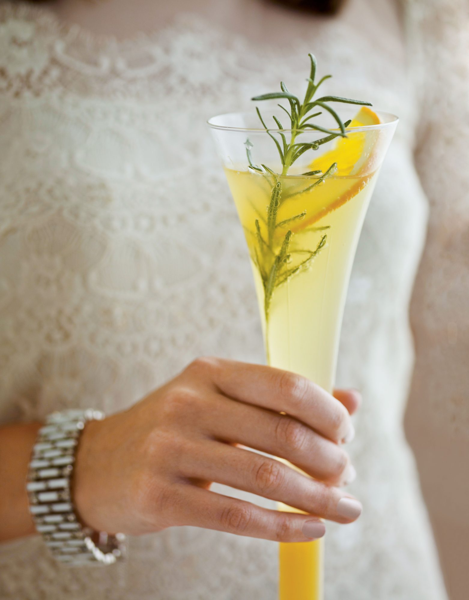 Woman Holding Champange Cocktail