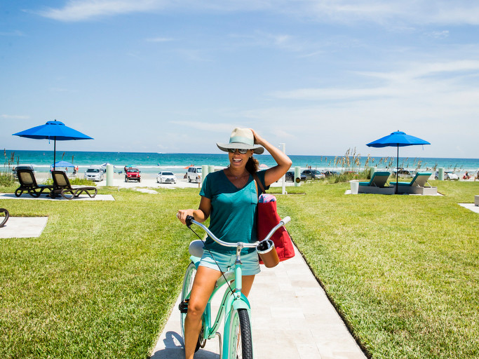 woman on bike at New Smyrna Beach