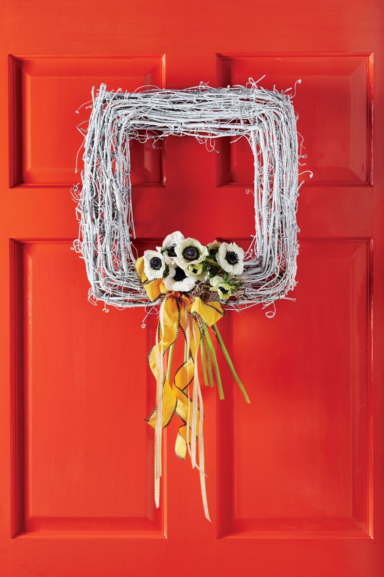 Red Door with White Square Wreath and Flowers