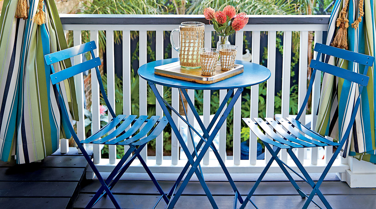 Blue Patio Chairs with Blue and Green Striped Curtains