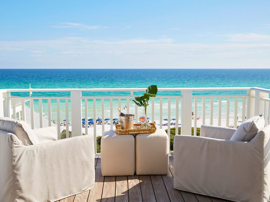 Two Lounge Chairs on the Deck Overlooking the Beach