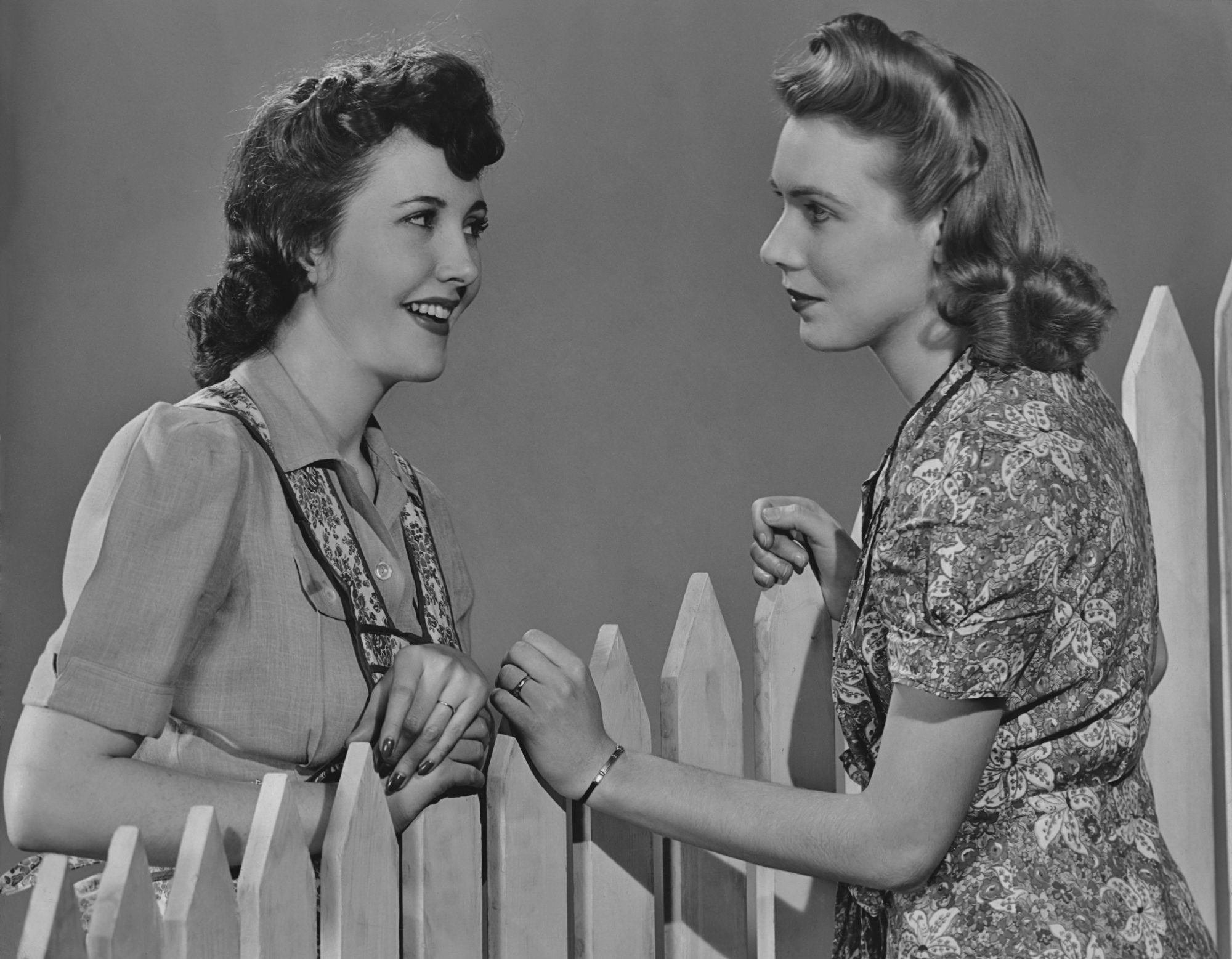 Two Women Talking Over Fence