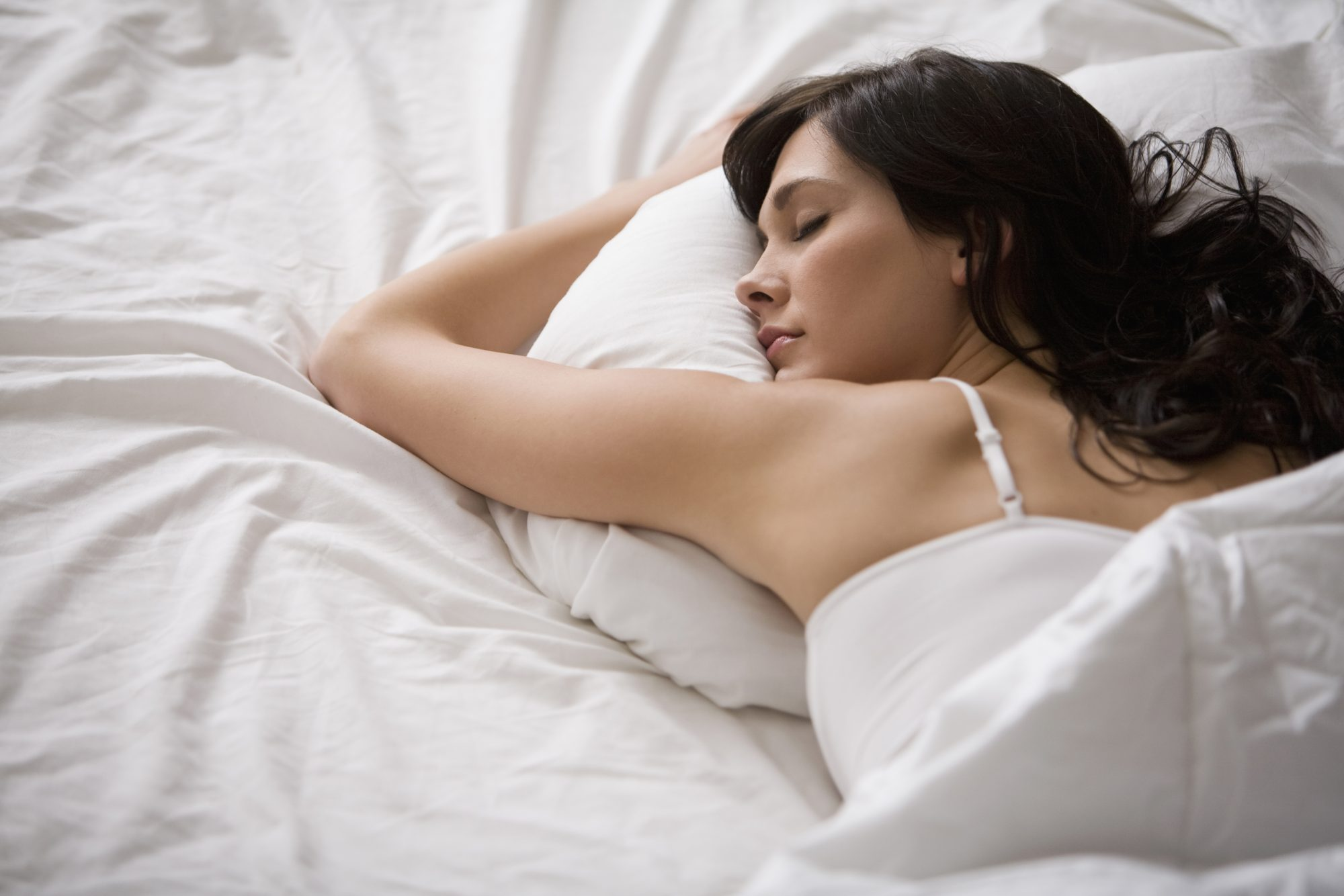 Caucasion Woman Sleeping in Bed