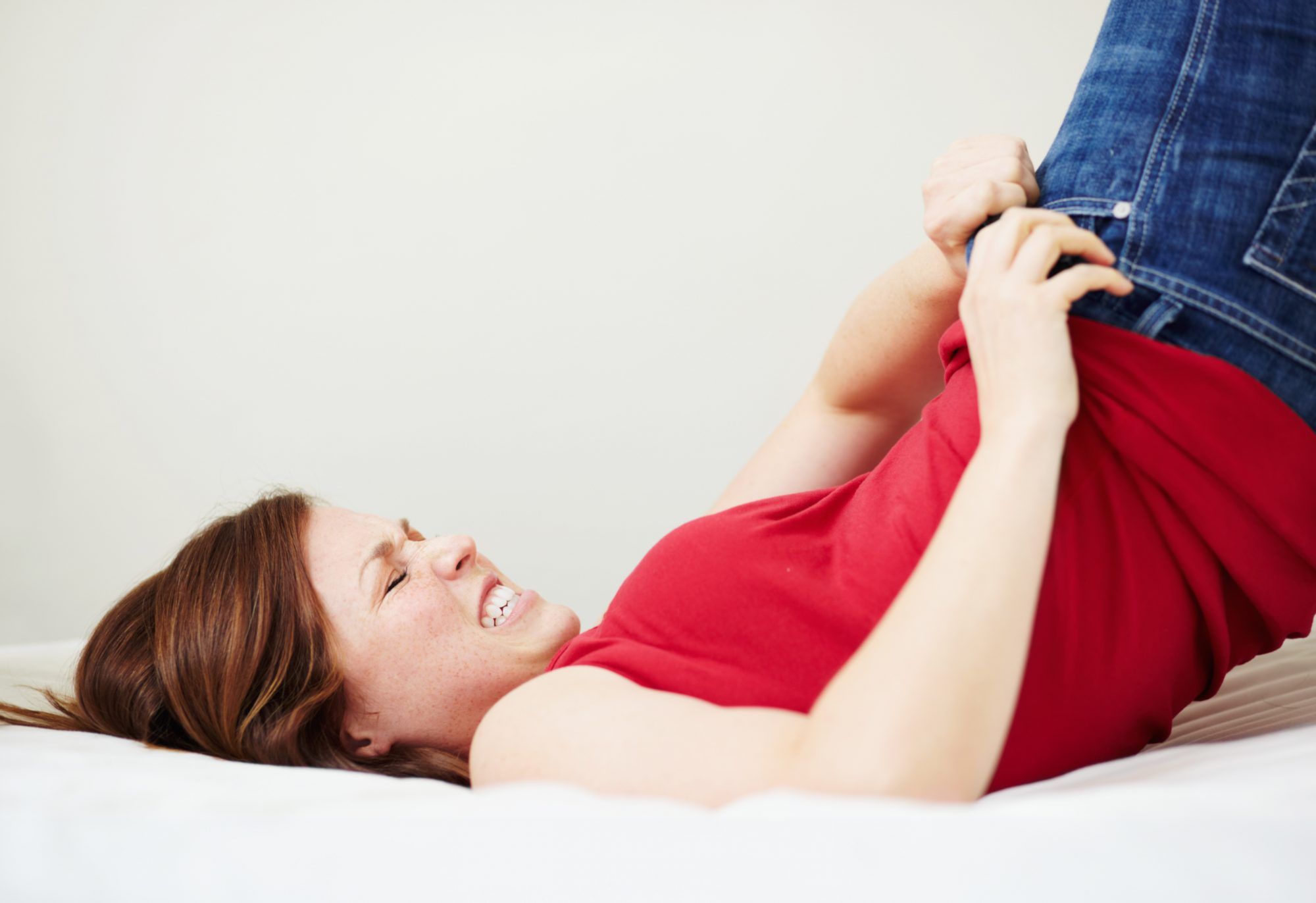 Woman Struggling to Pull Jeans Up